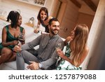 friends celebrating christmas... | Shutterstock . vector #1257879088