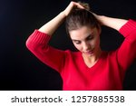 beautiful young woman fixing... | Shutterstock . vector #1257885538