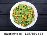 plate with autumn salad with... | Shutterstock . vector #1257891685