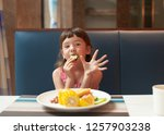 the concept of feeding a child... | Shutterstock . vector #1257903238