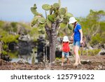 Mother And Daughter Hiking At...
