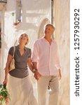 mature tourist couple walking... | Shutterstock . vector #1257930292