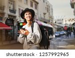 brunette tourist looking for... | Shutterstock . vector #1257992965