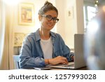 attractive young woman working... | Shutterstock . vector #1257993028