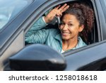black woman holding keys to new ... | Shutterstock . vector #1258018618
