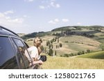 girl on a car for a road trip... | Shutterstock . vector #1258021765