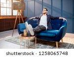 portrait of relaxed businessman ... | Shutterstock . vector #1258065748