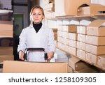 young woman worker standing... | Shutterstock . vector #1258109305