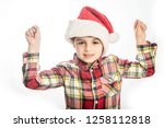 young cute boy with a santa's... | Shutterstock . vector #1258112818
