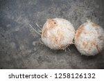 a fresh coconut preparing it... | Shutterstock . vector #1258126132