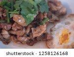 stir fried pork with garlic and ... | Shutterstock . vector #1258126168