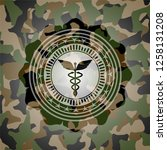 caduceus medical icon on camo... | Shutterstock .eps vector #1258131208