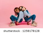 adorable girls sitting together ... | Shutterstock . vector #1258178128