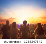 Small photo of International Human Solidarity Day concept: Blurred Christian Congregation Worship God together in Church hall in front of music stage and light effected