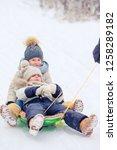 little adorable girls sledding... | Shutterstock . vector #1258289182