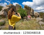 woman taking a photo or video... | Shutterstock . vector #1258348018