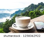 coffee cup on wooden table with ... | Shutterstock . vector #1258362922