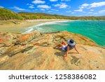 woman in hat sunbathing on the...   Shutterstock . vector #1258386082