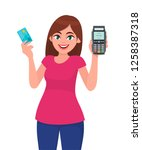 young woman holding pos payment ...   Shutterstock .eps vector #1258387318