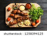 board with barbecued meat ...   Shutterstock . vector #1258394125
