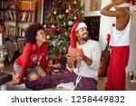 happy young african american... | Shutterstock . vector #1258449832