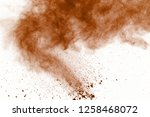 brown powder explosion on white ...   Shutterstock . vector #1258468072