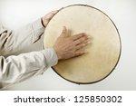 Someone Playing A  Tambourine...