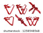 red ribbon isolated on white... | Shutterstock . vector #1258548568
