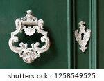 vintage antiqued door knocker... | Shutterstock . vector #1258549525