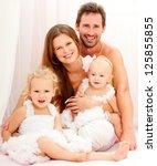 happy young family. indoors. | Shutterstock . vector #125855855