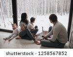 family at home in pajamas.... | Shutterstock . vector #1258567852