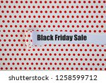 black friday written under torn ... | Shutterstock . vector #1258599712