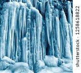 frozen small mountain waterfall ...   Shutterstock . vector #1258618822