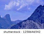 glider soaring above the...   Shutterstock . vector #1258646542