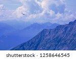 glider soaring above the...   Shutterstock . vector #1258646545