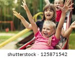 Happy Kids Playing On Slide