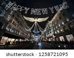 happy new year message hanging... | Shutterstock . vector #1258721095