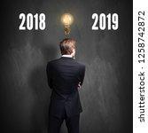 businessman standing in front... | Shutterstock . vector #1258742872