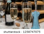 flutes of champagne with bottle ... | Shutterstock . vector #1258747075
