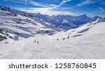 group of people snowboarding on ... | Shutterstock . vector #1258760845
