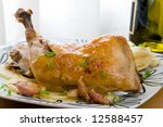 roasted chicken legs with french potatoes and herbs - stock photo