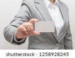 woman hand holding a business... | Shutterstock . vector #1258928245