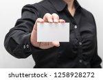 woman hand holding a business... | Shutterstock . vector #1258928272