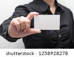 woman hand holding a business... | Shutterstock . vector #1258928278