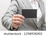 woman hand holding a business... | Shutterstock . vector #1258928302