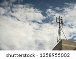 cellular phone pole at the roof ... | Shutterstock . vector #1258955002