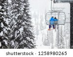 Skiing Couple On Chairlift