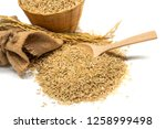 food background. brown rice in... | Shutterstock . vector #1258999498