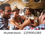 young cheerful people in the... | Shutterstock . vector #1259001385