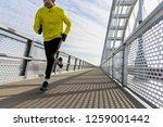 attractive fit man running fast ... | Shutterstock . vector #1259001442
